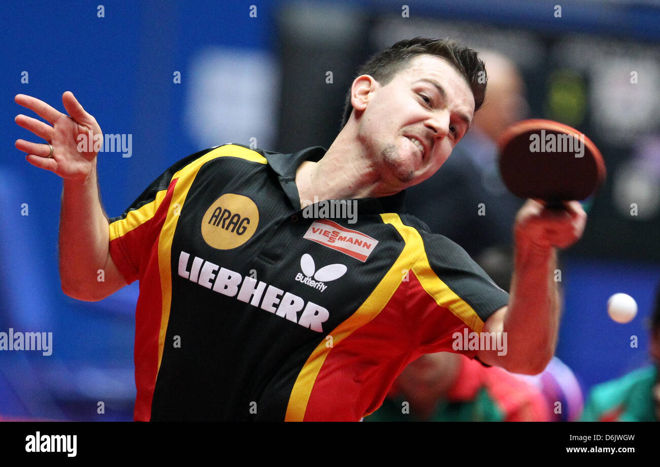 Germany's Timo Boll hits the ball during the men's group B match against Monteiro from Portugal at the 2012 - Stock Image