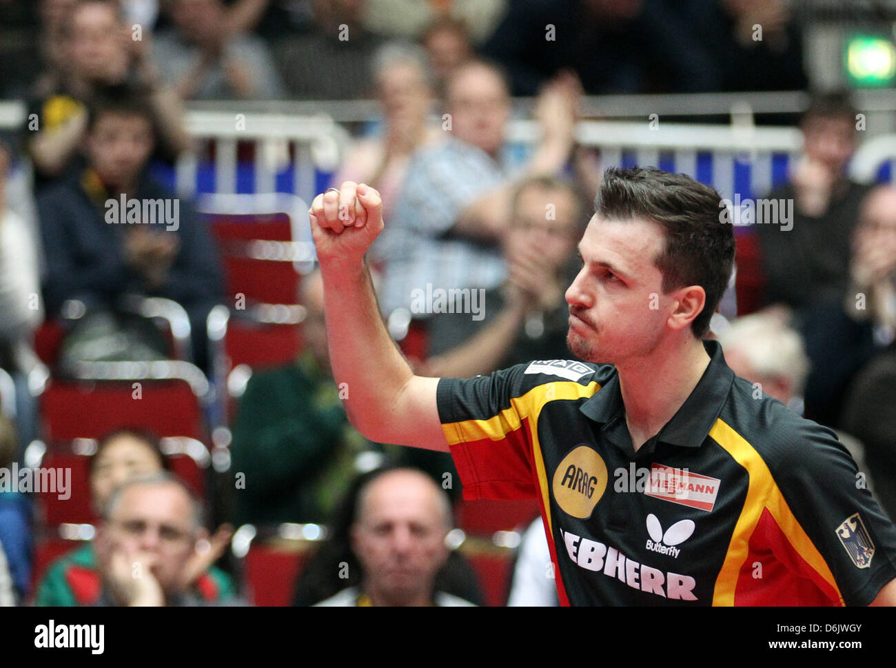Germany's Timo Boll celebrates his victory of the men's group B match against Monteiro from Portugal at - Stock Image