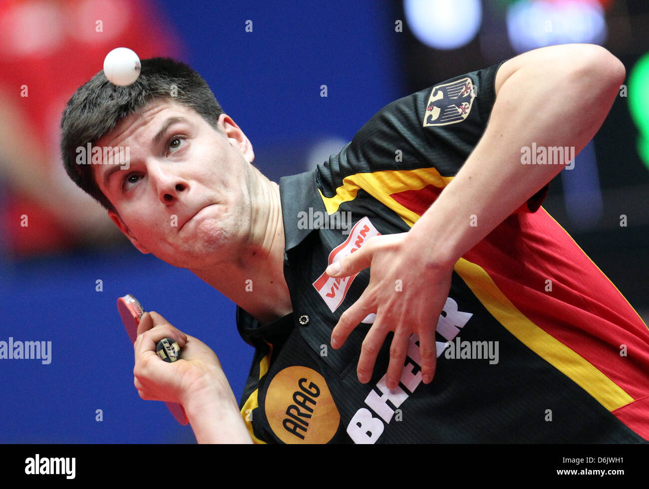 Germany's Dimitrij Ovtcharov hits the ball during the men's group B match against Freitas from Portugal - Stock Image