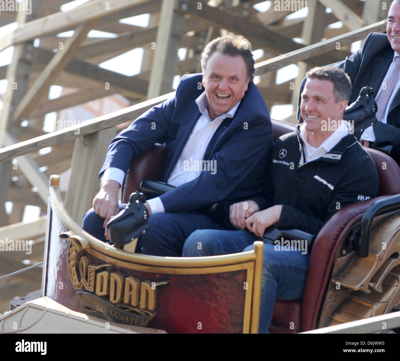 Roland Mack, managing director of Europa-Park (L) and former Formula One driver Ralf Schuhmacher ride in a car of - Stock Image