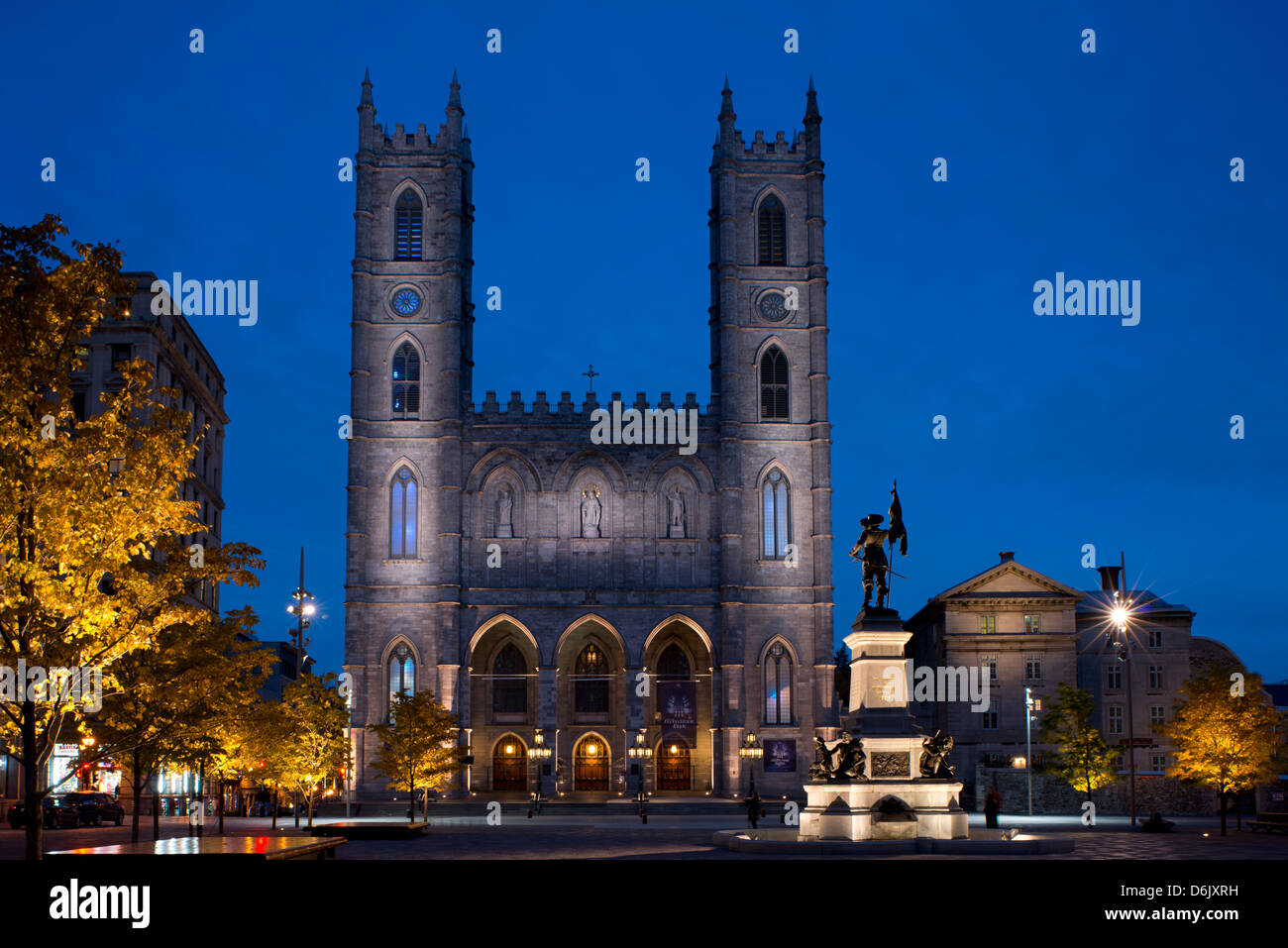 The Notre Dame Cathedral at dusk in the Place d'Arms, Montreal, Quebec Province, Canada, North America - Stock Image