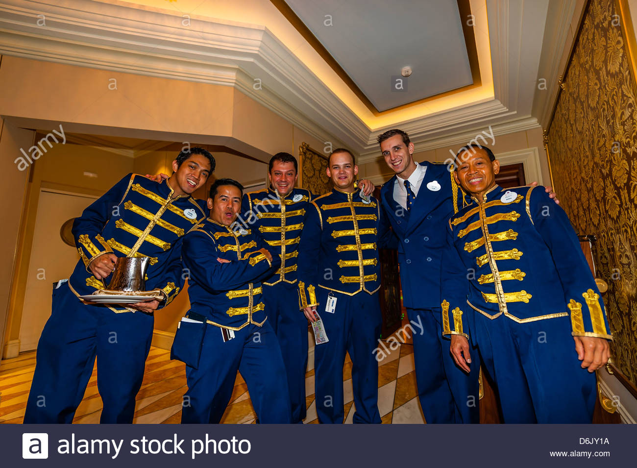 Waiters, Royal Palace restaurant, Disney Dream cruise ship sailing between Florida and the Bahamas - Stock Image