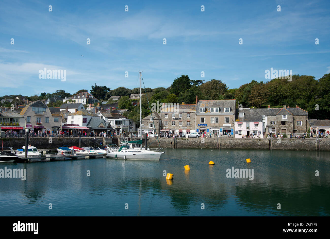 A view of the quaint stone buildings around the harbour in Padstow, Cornwall, England, United Kingdom, Europe - Stock Image