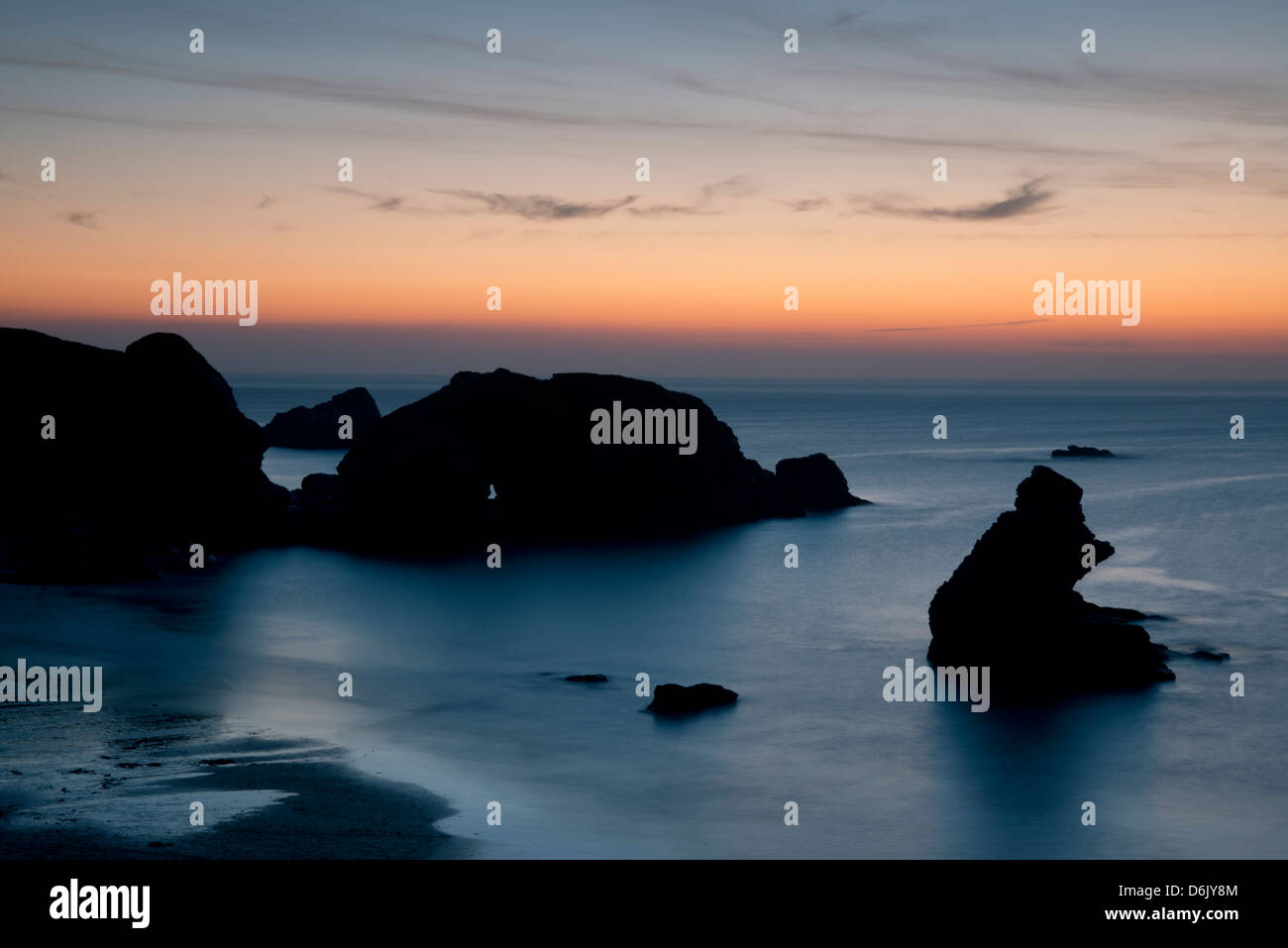 Sunset over unusual rock formations in Porthcothan Bay, Cornwall, England, United Kingdom, Europe - Stock Image