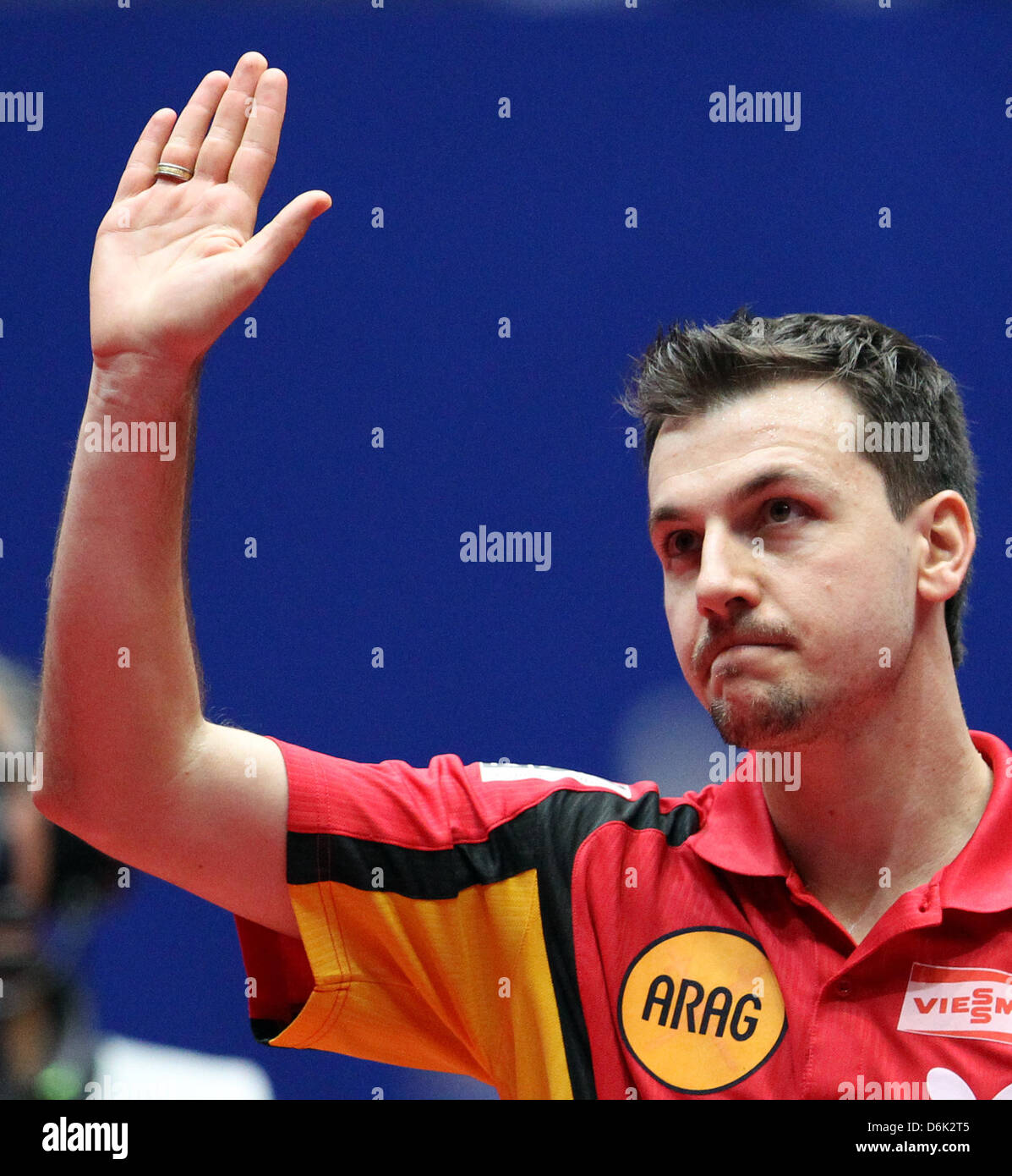 Germany's Timo Boll celebrates his victory during the men's quarterfinal match against Sweden's Lundqvist - Stock Image