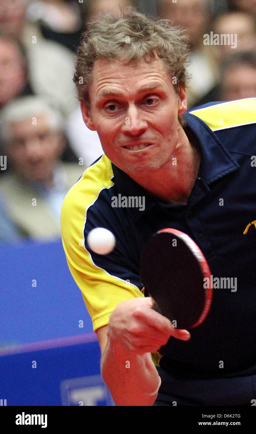 Sweden's Joergen Persson hits the ball during the men's quarterfinal match against Germany's Ovtcharov - Stock Image