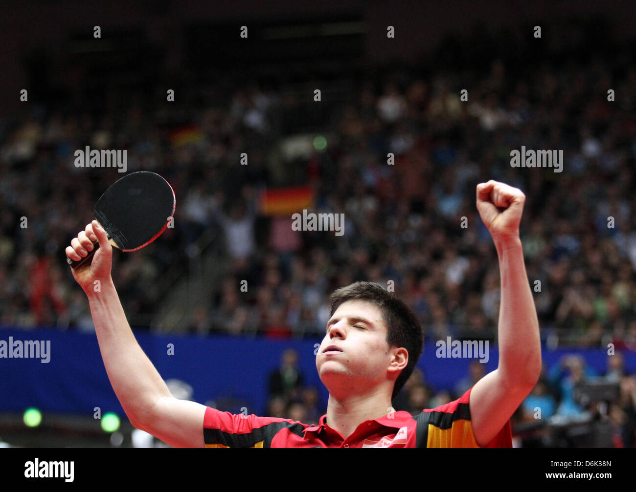 Germany's Dimitrij Ovtcharov celebrates his victory in the men's semifinal match against Mizutani of Japan - Stock Image