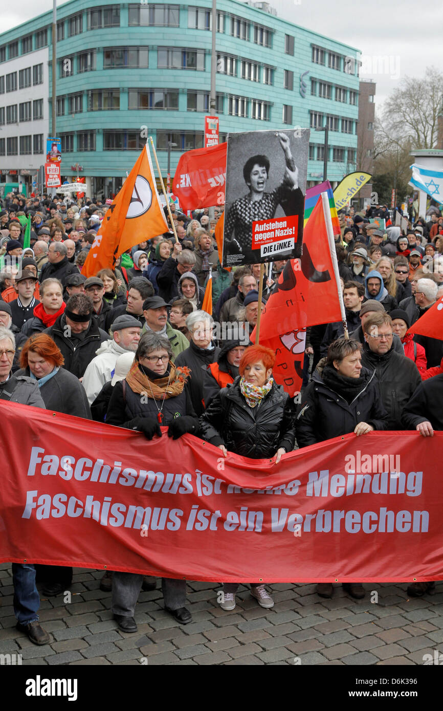 Protesters hold placards and banners in their hands which read 'Faschismus ist keine Meinung - Faschismus ist ein Stock Photo