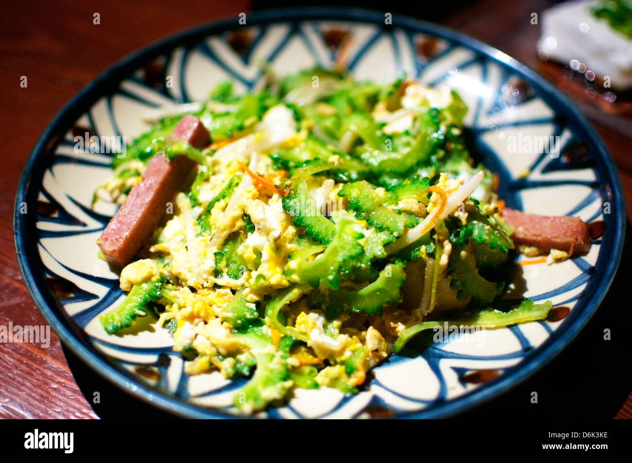 Goya Chanpuru, a typical okinawan Dish. It is Goya fruit with Tofu, Egg and Meat. - Stock Image