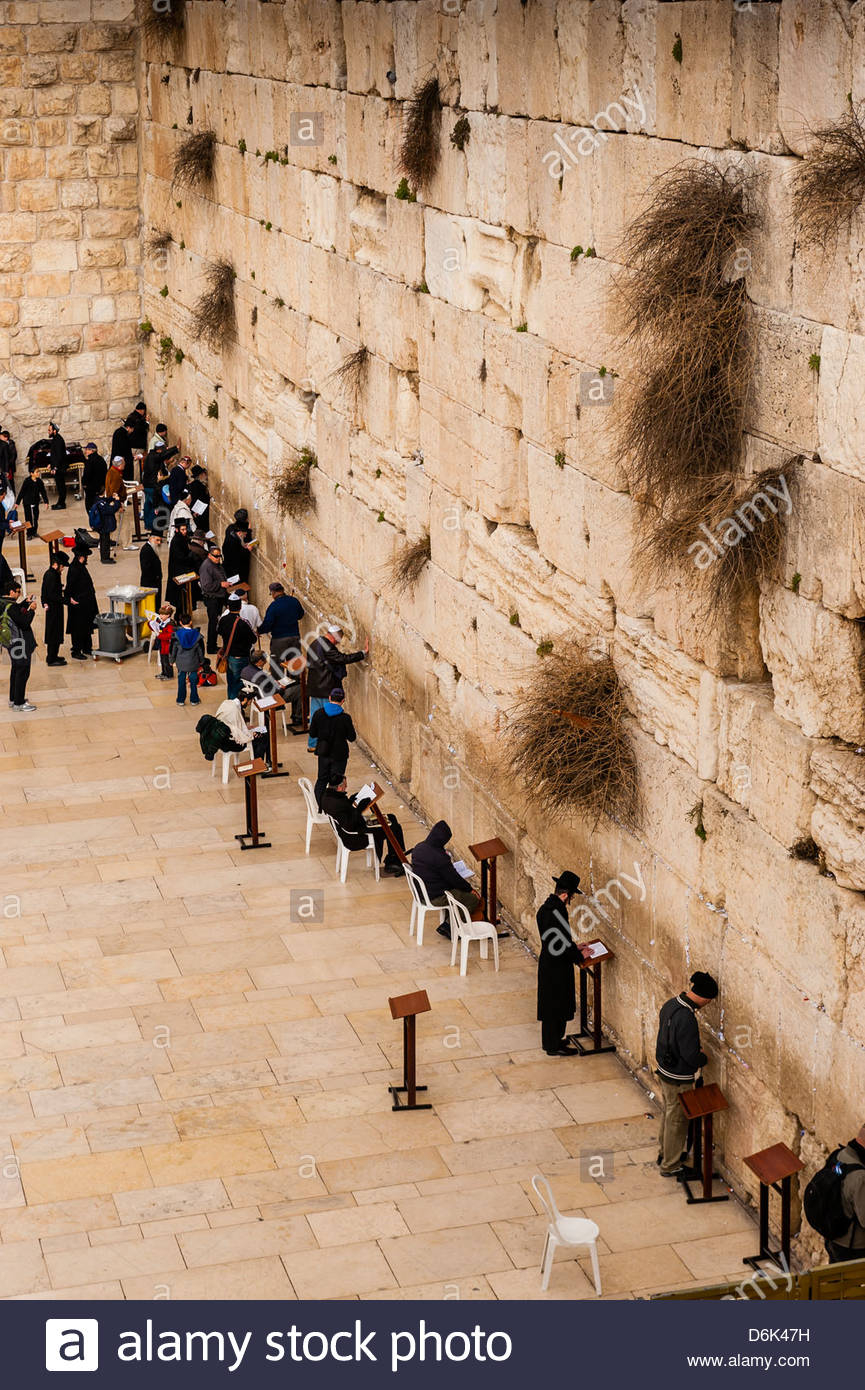 Jewish men praying in the men's section of the Western Wall (Wailing Wall), the Temple Mount, Old City, Jerusalem, - Stock Image