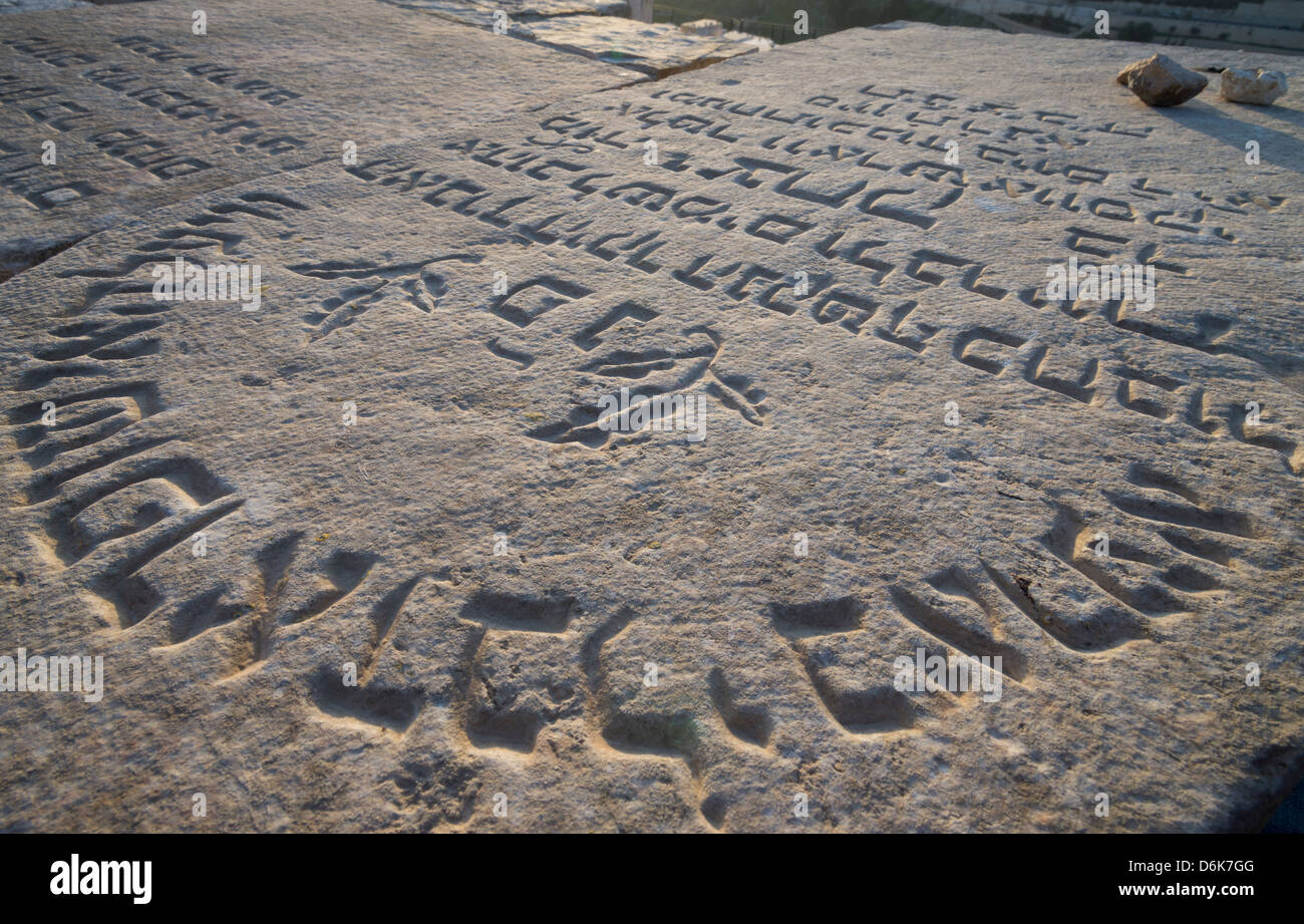 Close up of a tomb stones on the Mount of Olives with Hebrew writings. Jerusalem. Israel. - Stock Image