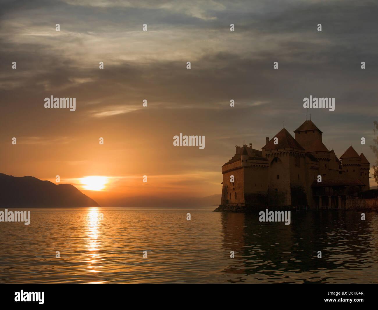 The Castle of Chillon, on Lake Geneva at sunset, Montreux, Canton Vaud, Switzerland, Europe - Stock Image