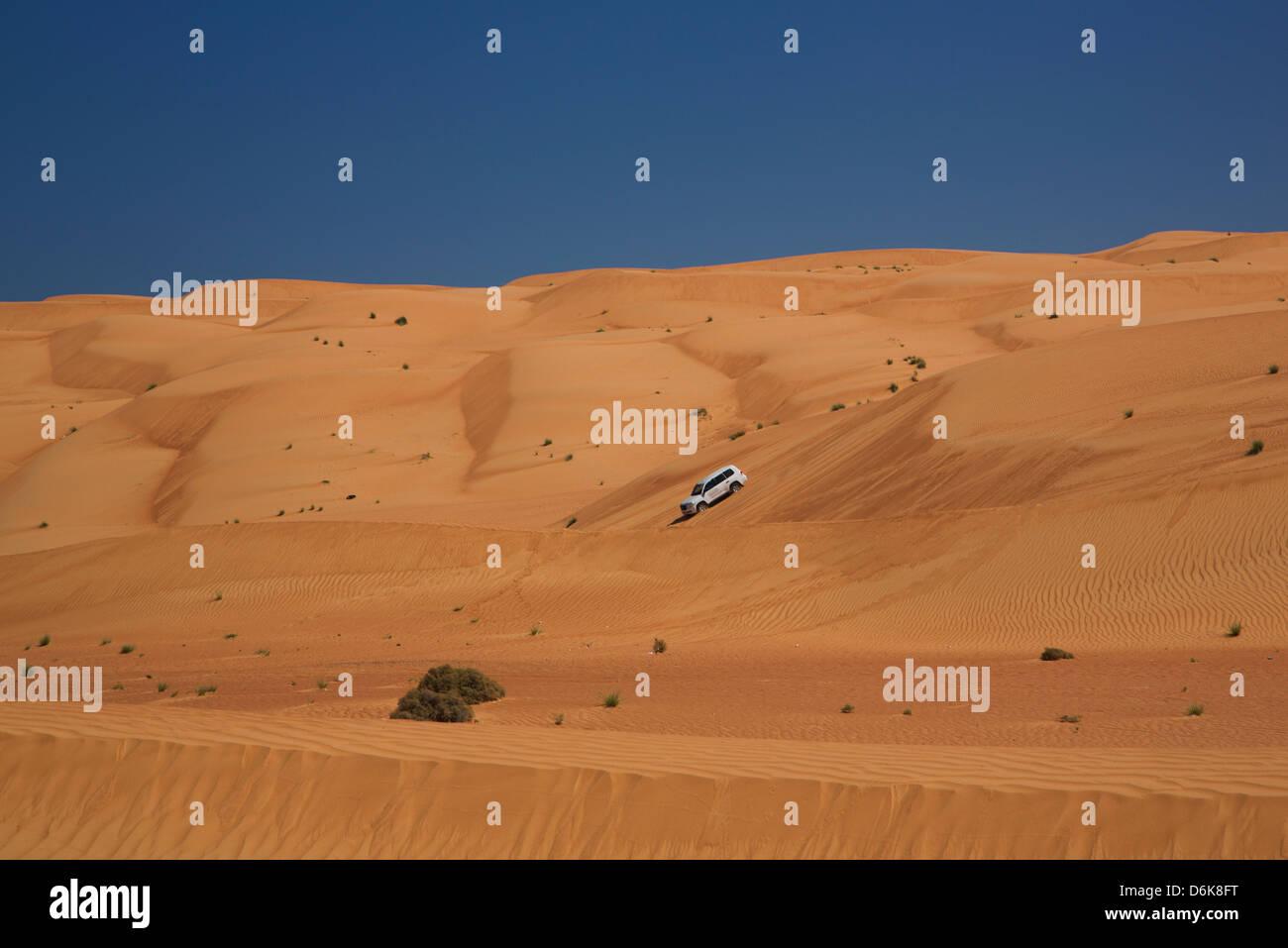 Four wheel drive on desert dunes, Wahiba, Oman, Middle East - Stock Image
