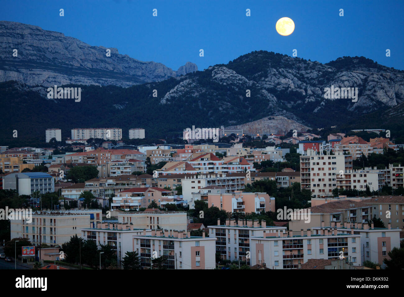 The full moon above the city of Marseille - Stock Image