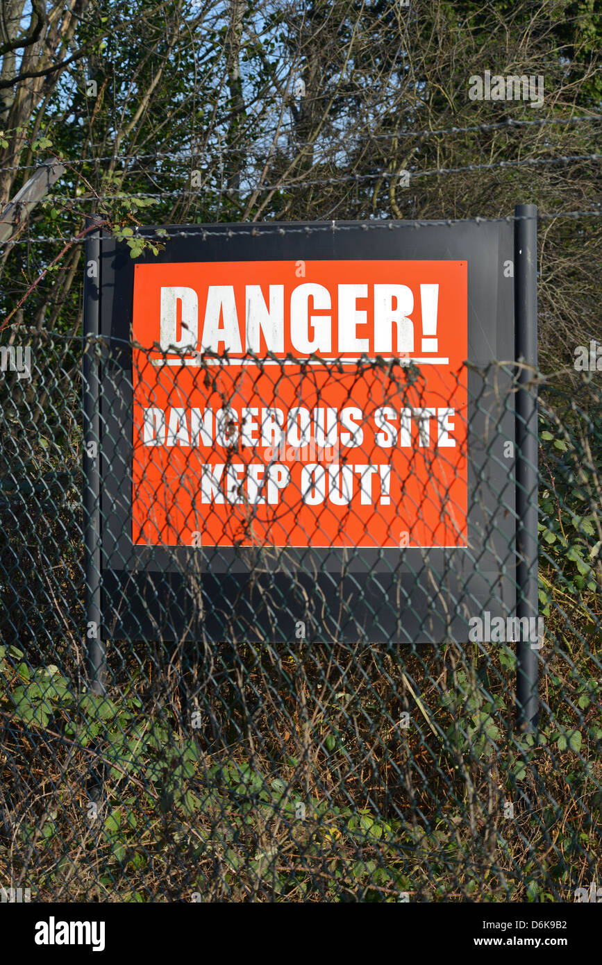 keep out warning sign of dangerous industrial site leeds yorkshire united kingdom - Stock Image