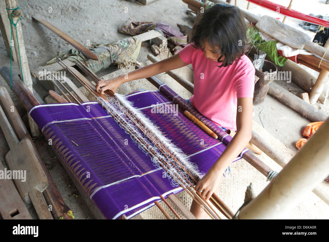 Batak tribeswoman weaving sarong with Batak Toba design, Buhit, Samosir Island, Lake Toba, Sumatra, Indonesia, Southeast - Stock Image