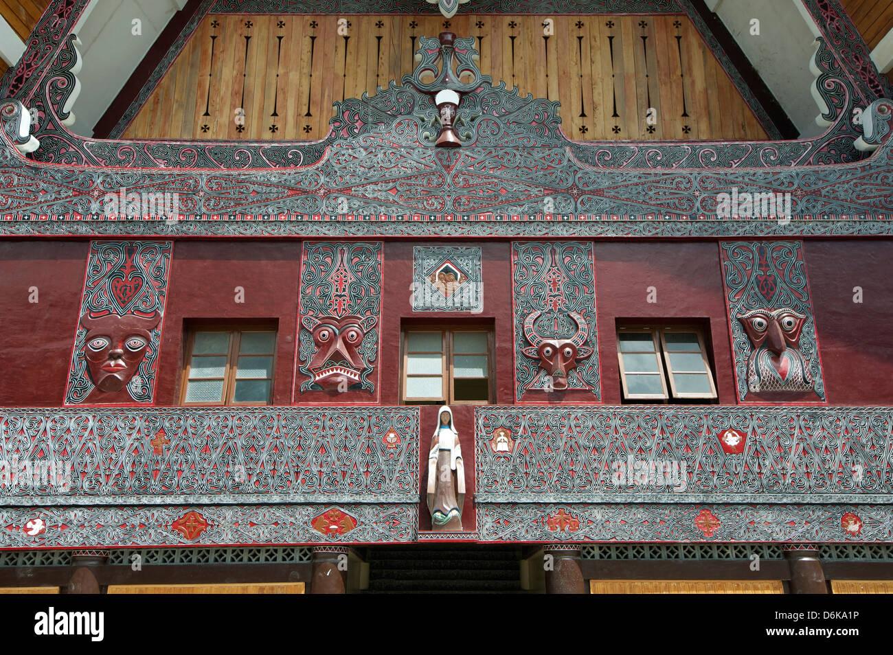 Batak painted carvings on large Batak style Catholic church, Pangururan, Samosir Island, Sumatra, Indonesia, Southeast - Stock Image