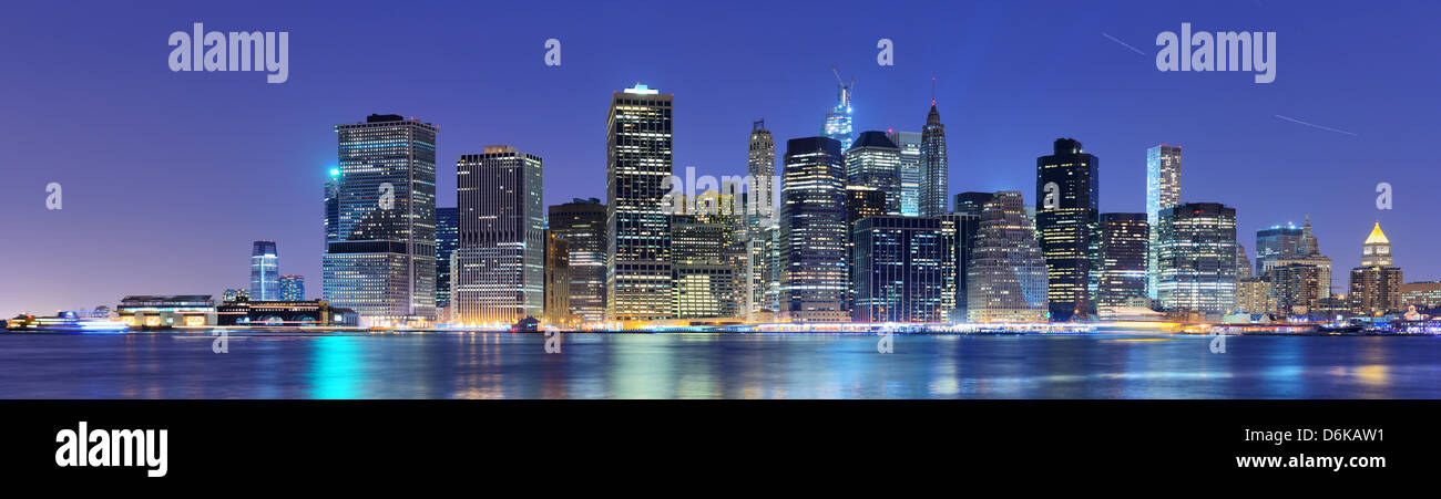 New York City panorama with the Brooklyn Bridge and the Financial district from across the East River. Stock Photo