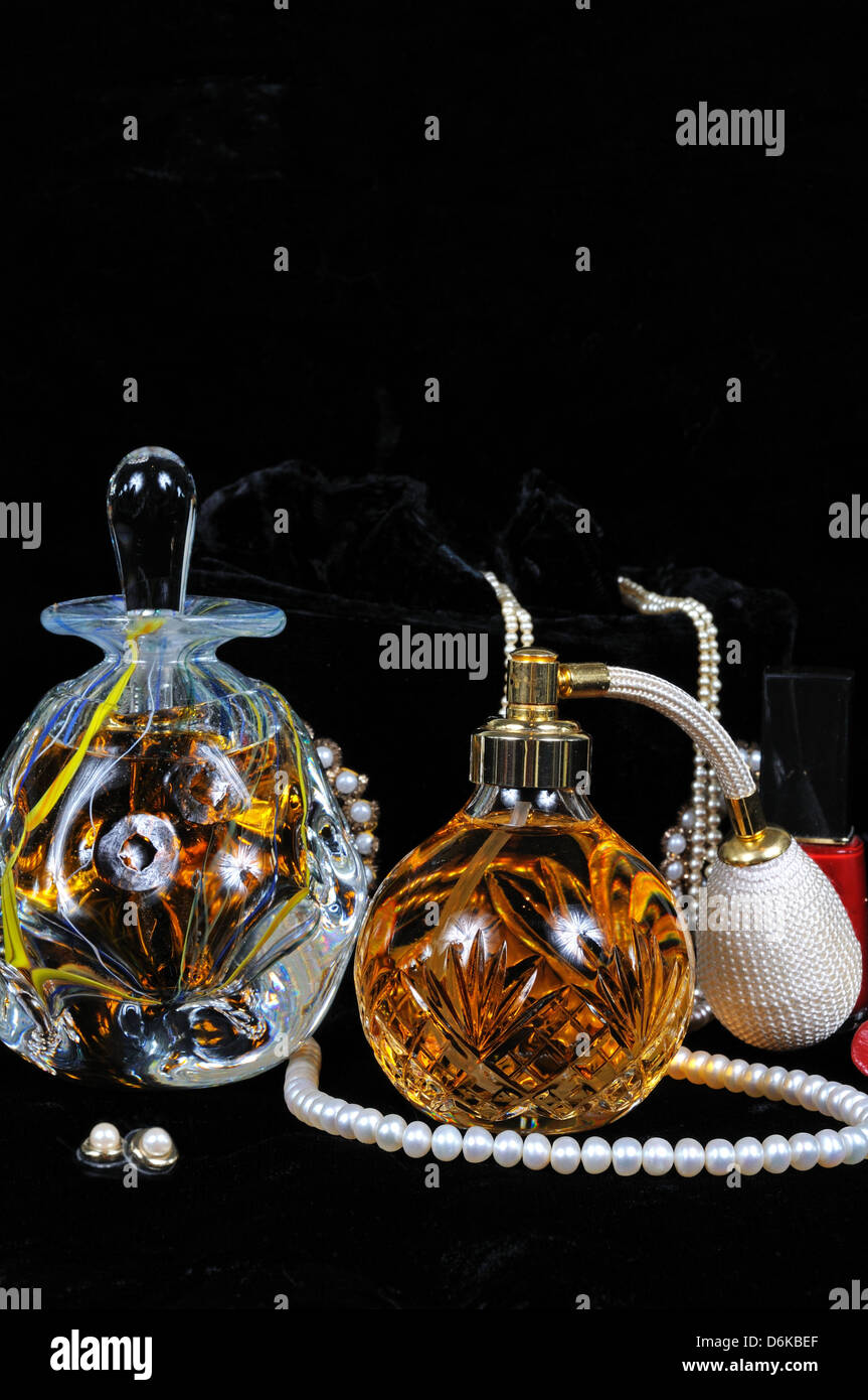 Perfume atomiser bottle, Perfume bottle with stopper and jewellery. - Stock Image