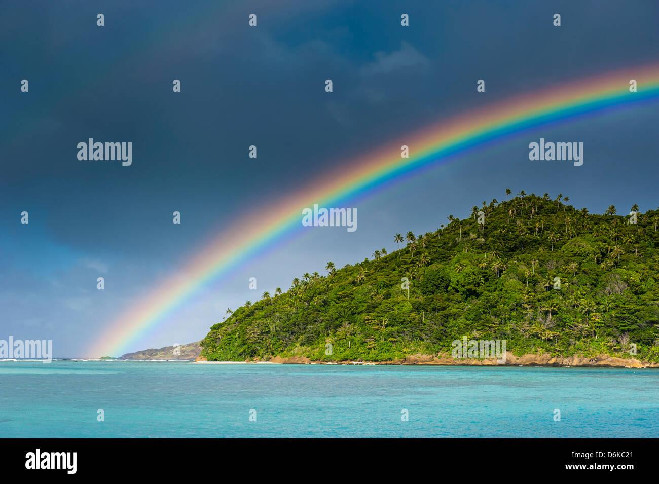 Incredble rainbow over an islet off Ofu Island, Manua Island group, American Samoa, South Pacific, Pacific - Stock Image