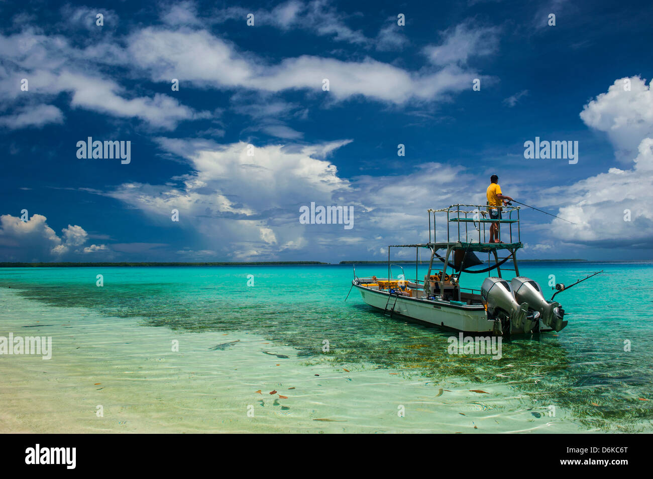 Little motor boat in the turquoise waters of the Ant Atoll, Pohnpei, Micronesia, Pacific Stock Photo