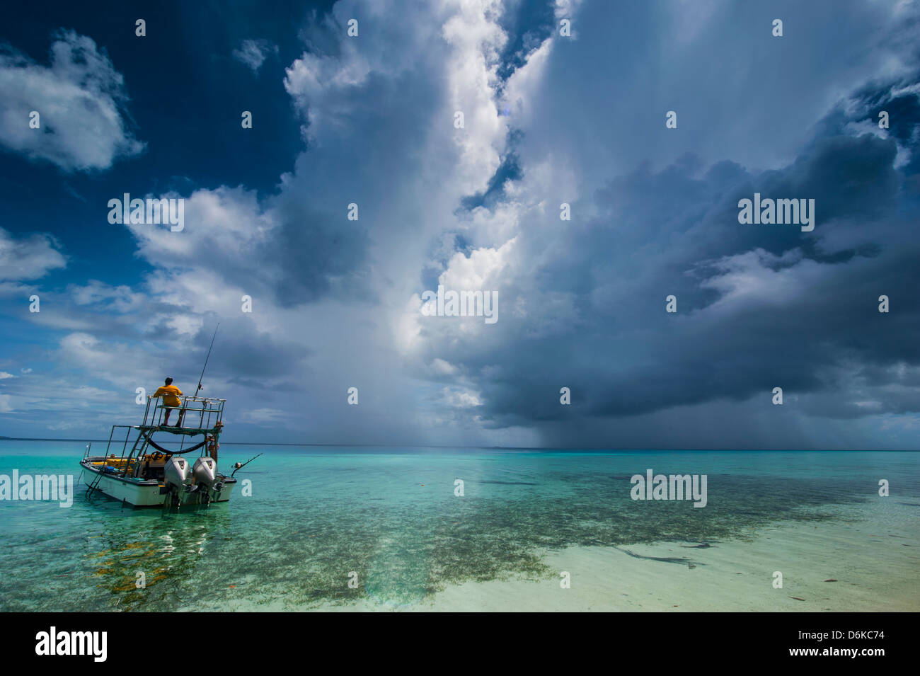Little motor boat in the turquoise waters of the Ant Atoll, Pohnpei, Micronesia, Pacific - Stock Image
