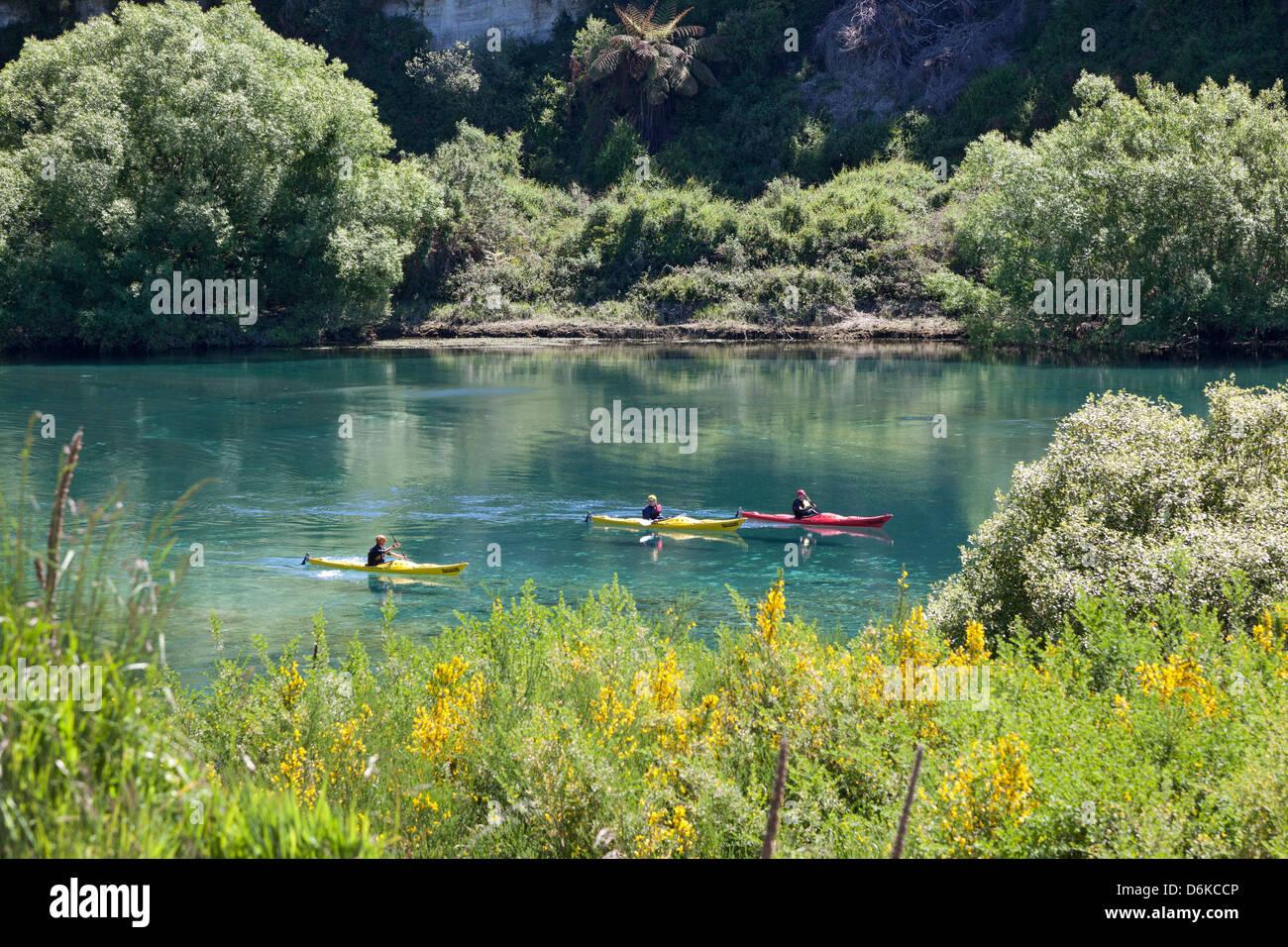 Canoes on the Waikato Rive near Taupo New Zealand - Stock Image