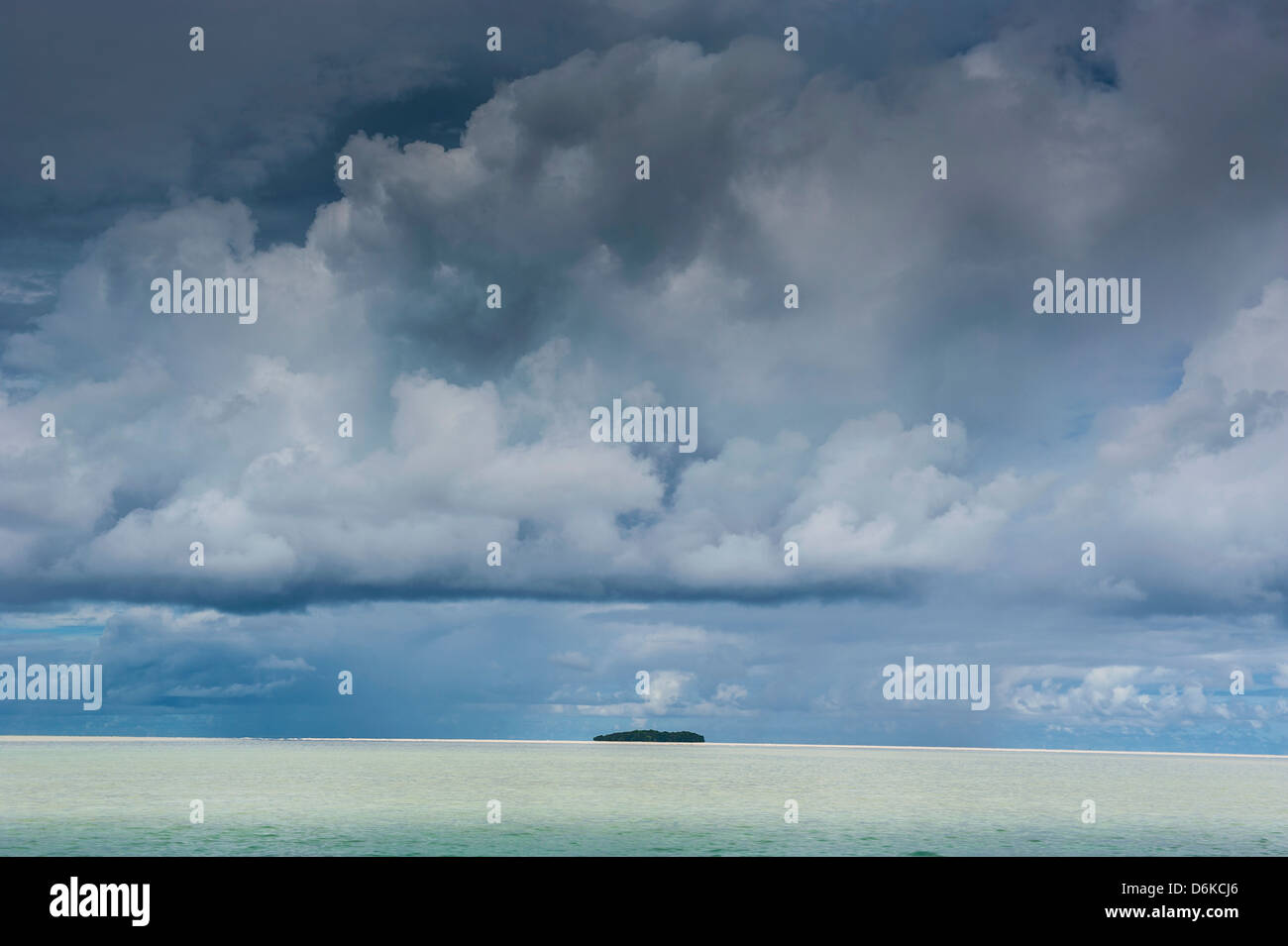 Dramatic sky over a little island in the Rock islands, Palau, Central Pacific, Pacific - Stock Image