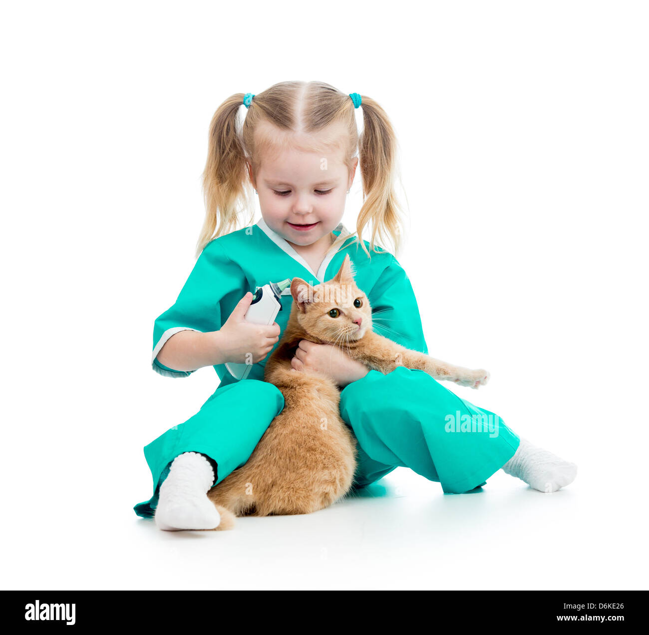 doctor girl playing and measuring cat temperature - Stock Image