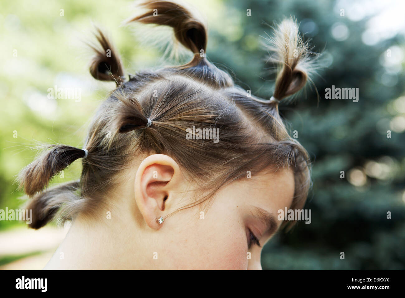 8 year old girl with pig tails - Stock Image