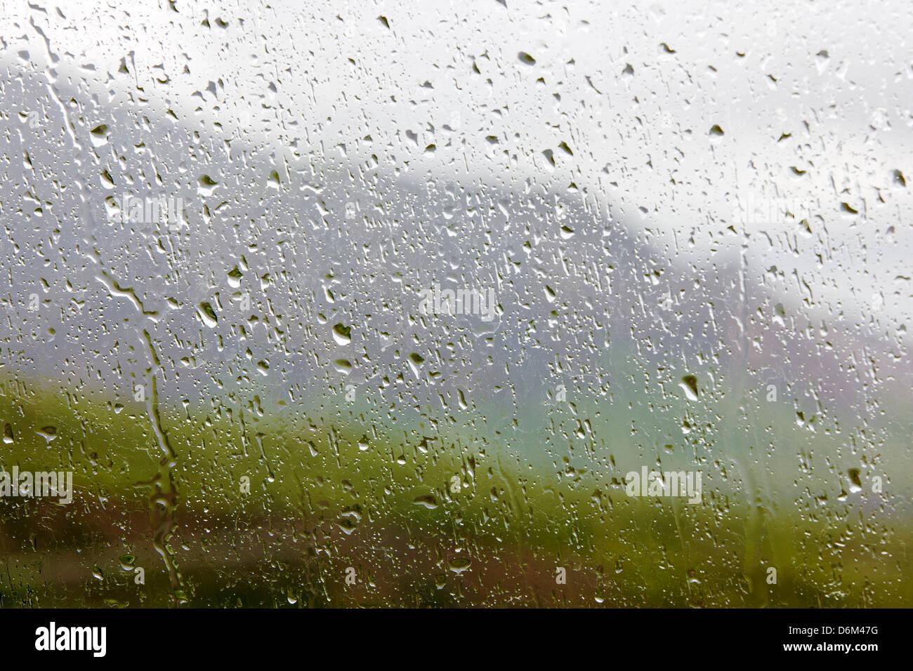 Rainy view south of the Alaska Range through a we car window from Polychrome Pass, Denali National Park, Alaska, - Stock Image