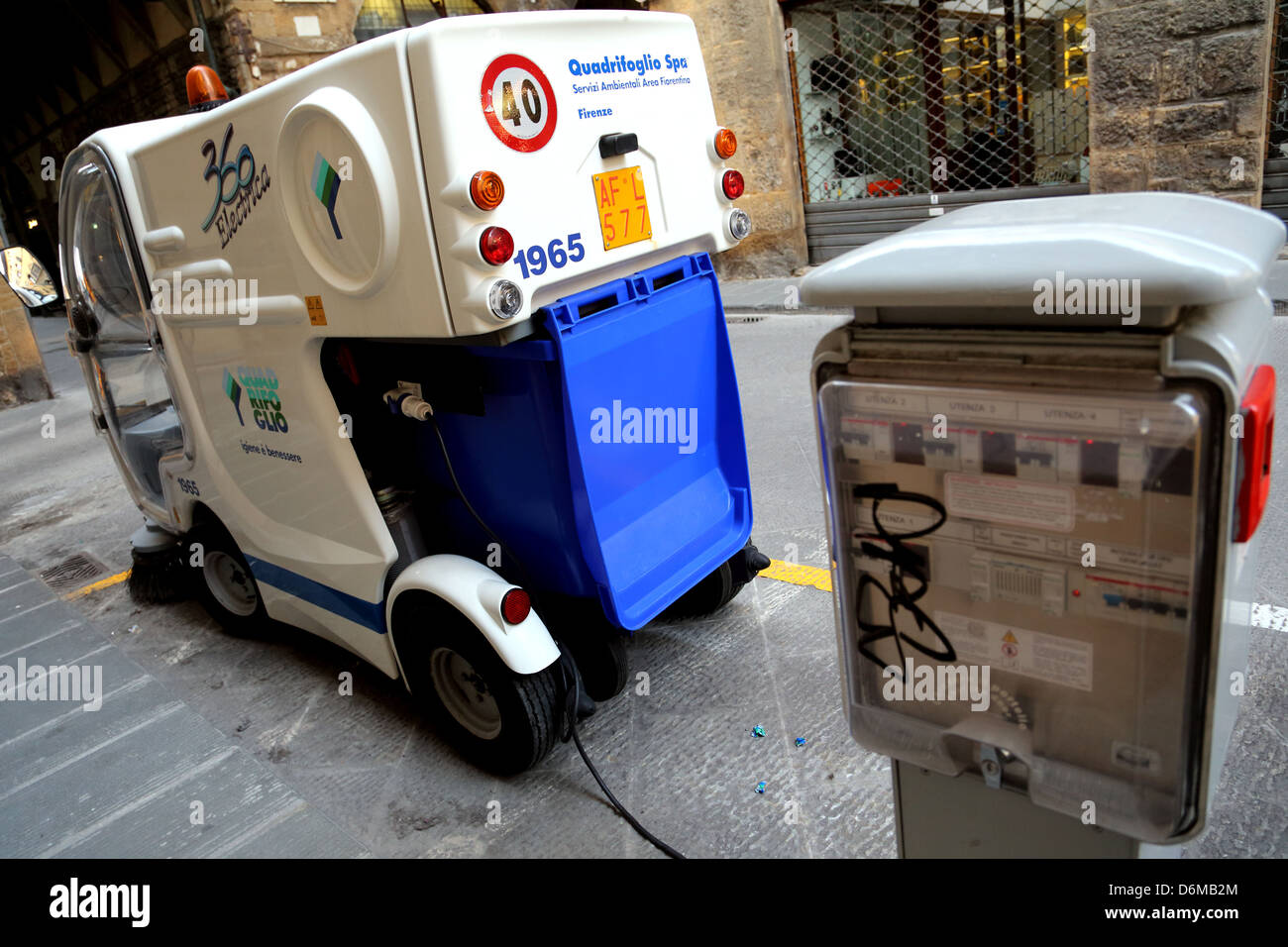 Battery powered street sweeper being recharged overnight in Florence Italy - Stock Image