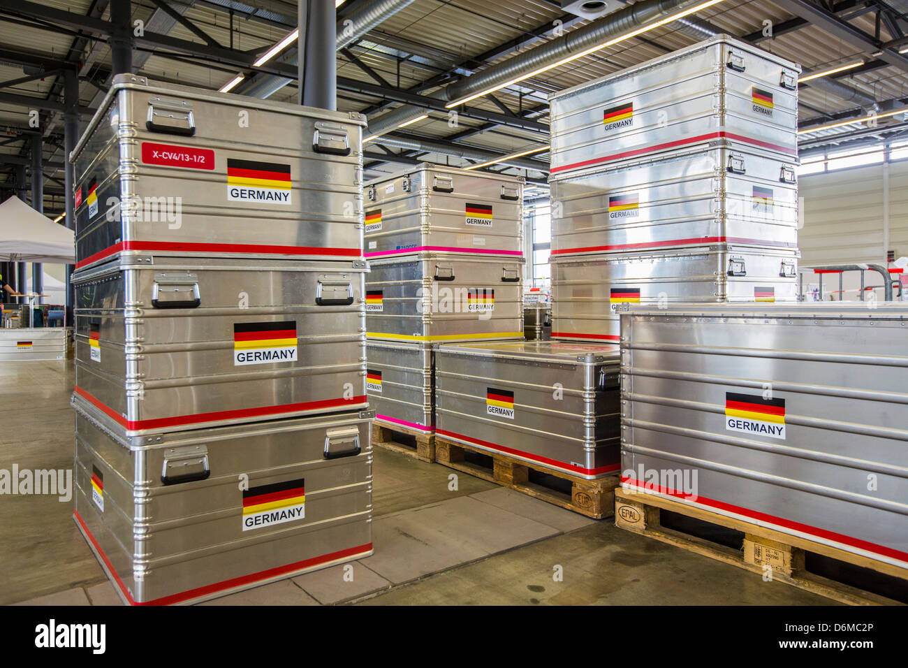 Aluminum transport boxes for emergency equipment. German flag. German disaster relief team unit, THW. - Stock Image