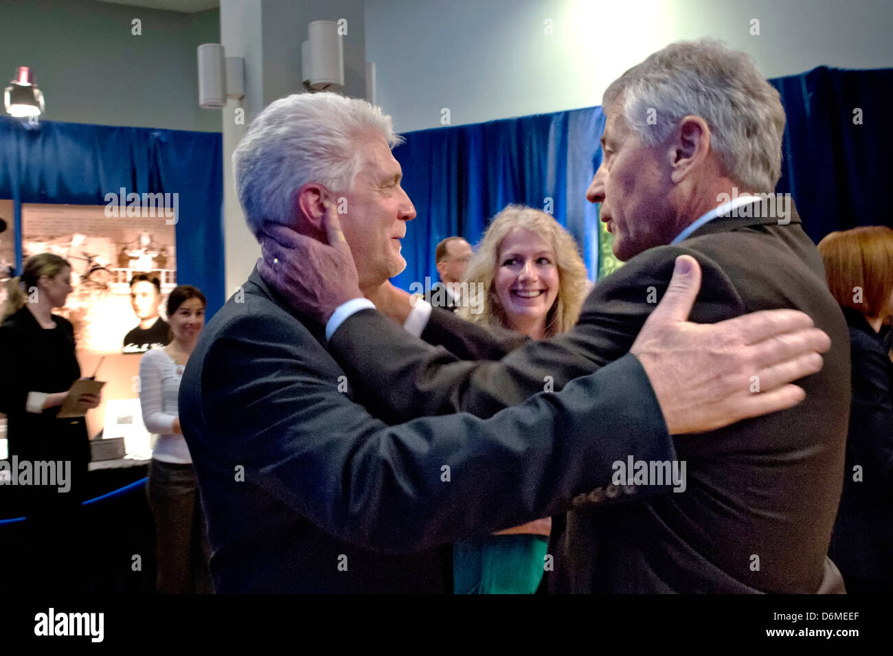 US Secretary of Defense Chuck Hagel hugs Ray Kapaun during a ceremony inducing his uncle, Army Chaplain Emil Kapaun, - Stock Image