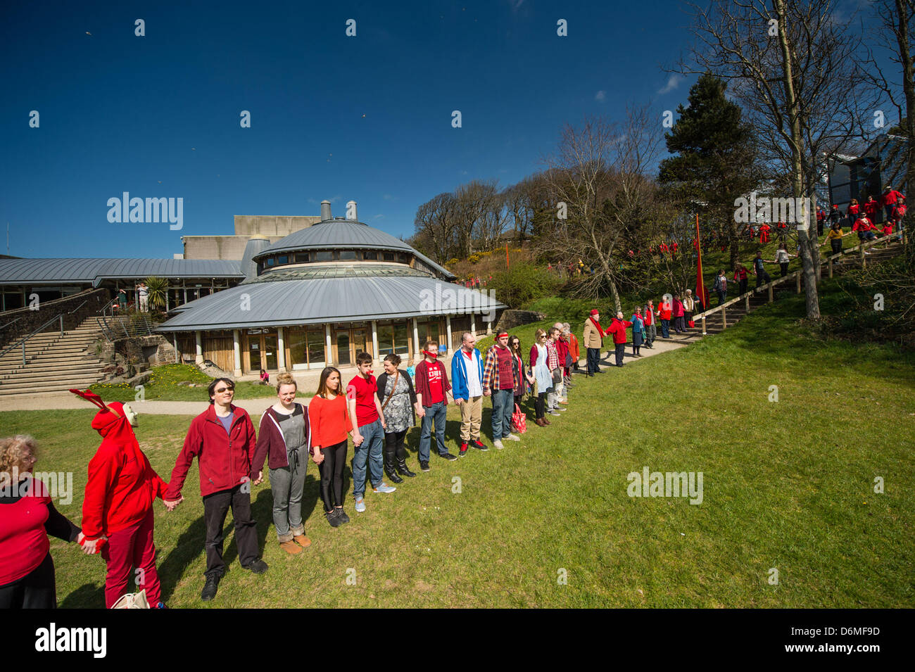 Aberystwyth Wales UK. 20th April, 2013.    Over 600 people gathered to encircle Aberystwyth Arts Centre in a silent - Stock Image