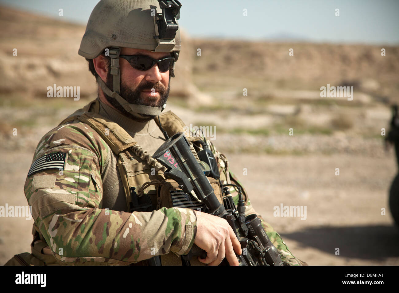 A US Special Forces soldier keeps watch during a patrol with Afghan National Army Special Forces escorting a district - Stock Image
