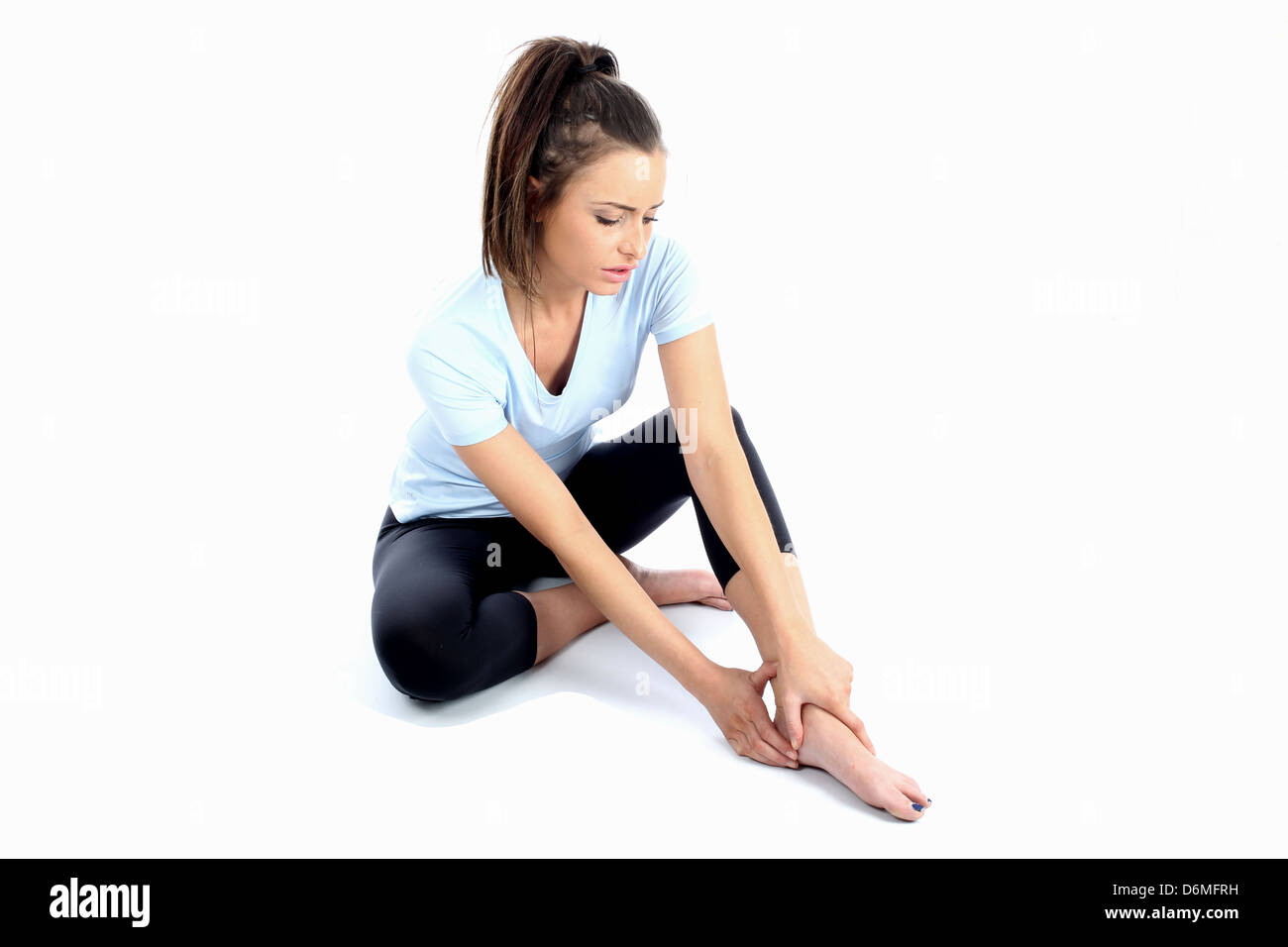 Model Released. Woman With Ankle Sports Injury - Stock Image