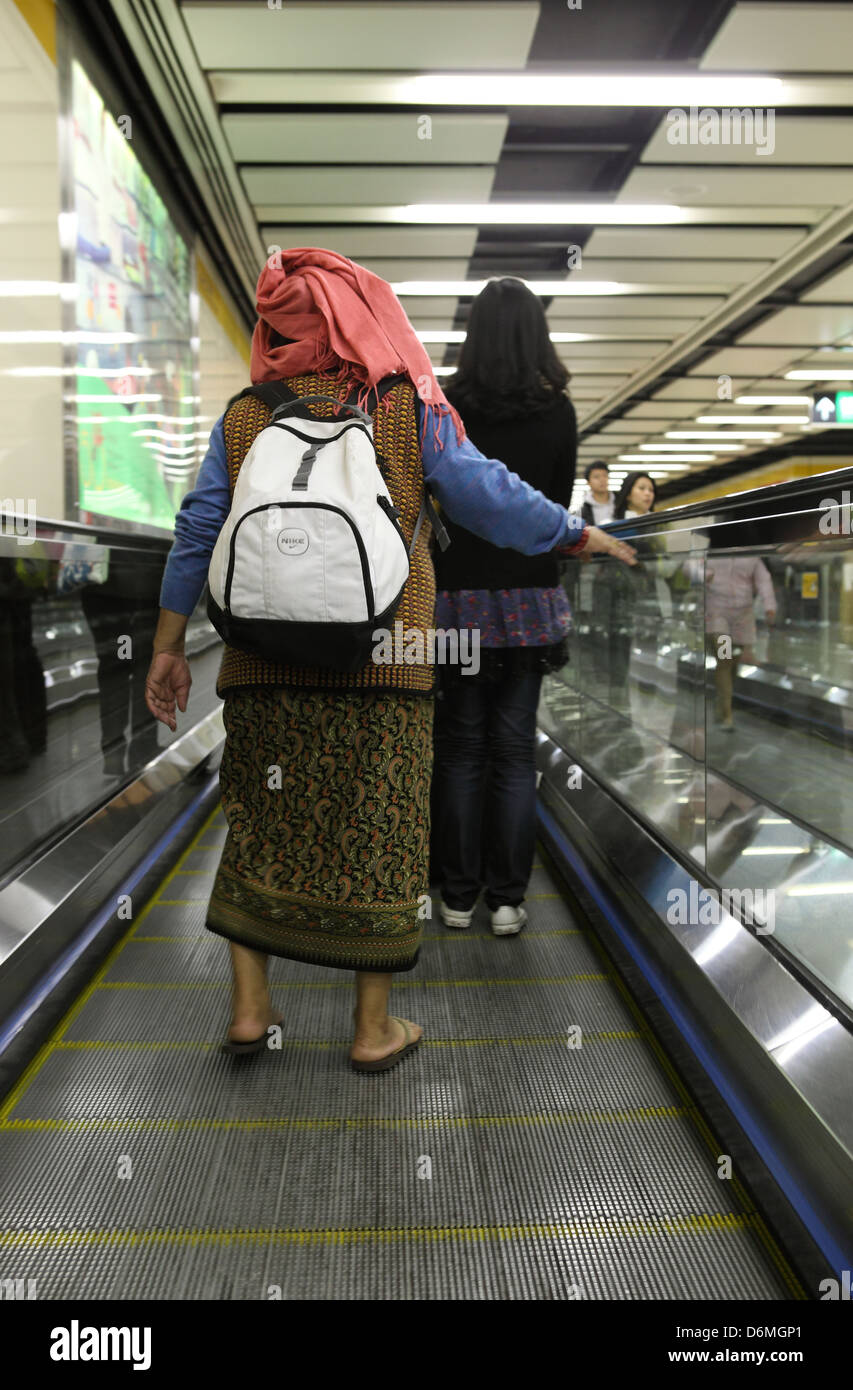 Hong Kong, China, women on a moving walkway Stock Photo