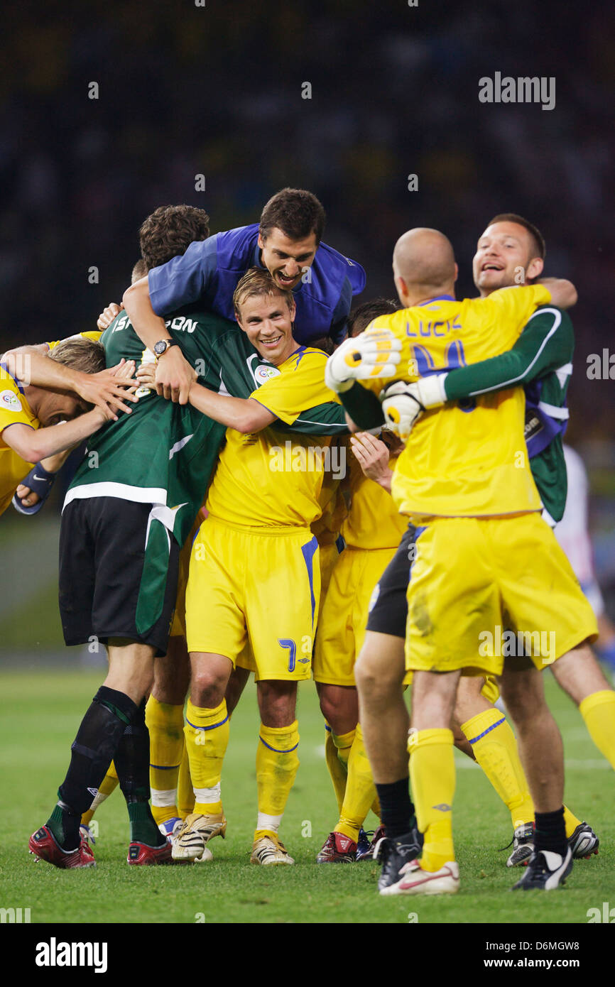 Sweden players celebrate after defeating Paraguay in a FIFA World Cup Group B match at Olympic Stadium on June 15, - Stock Image