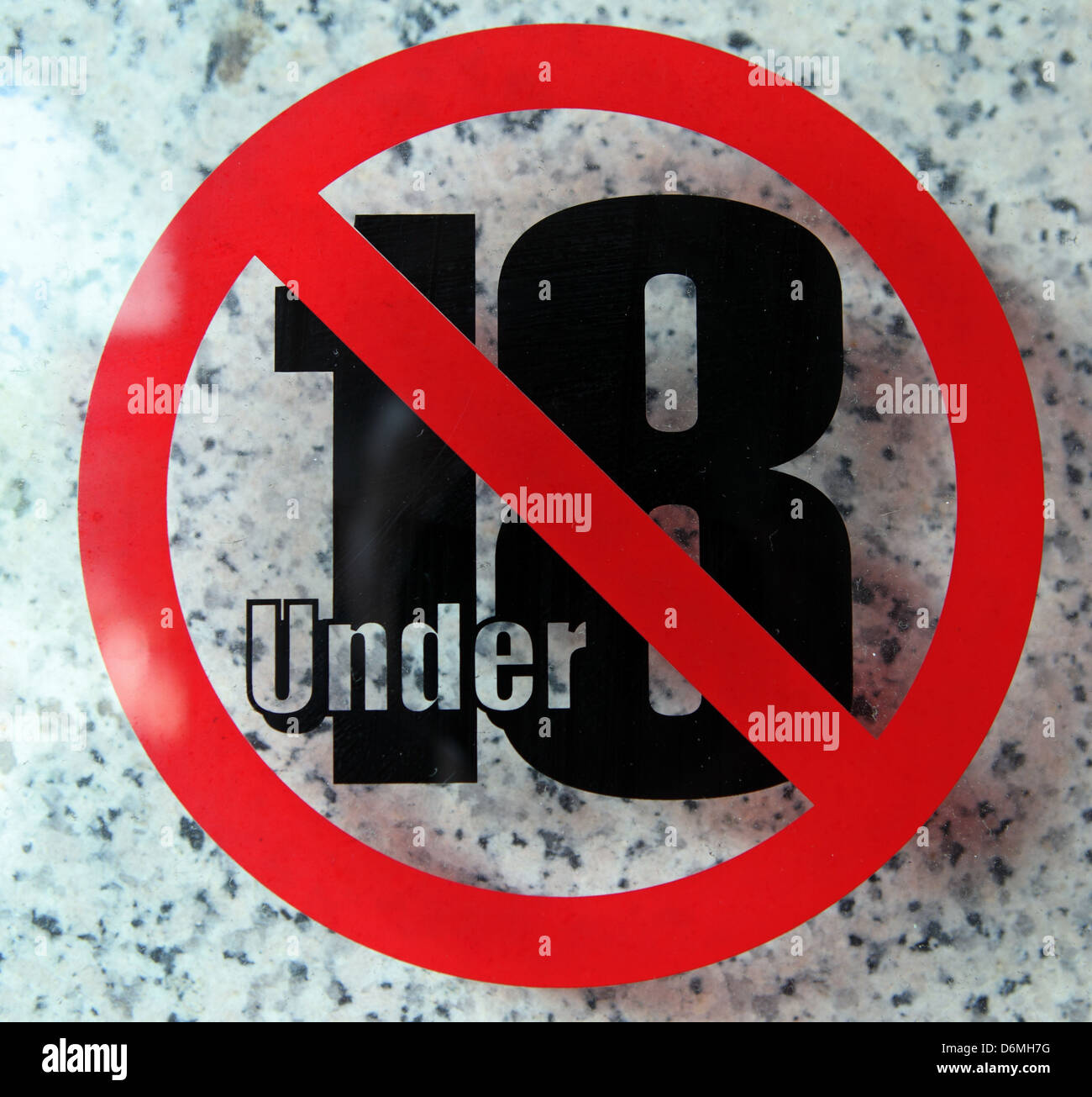 Sign, access forbidden for people under 18 years - Stock Image