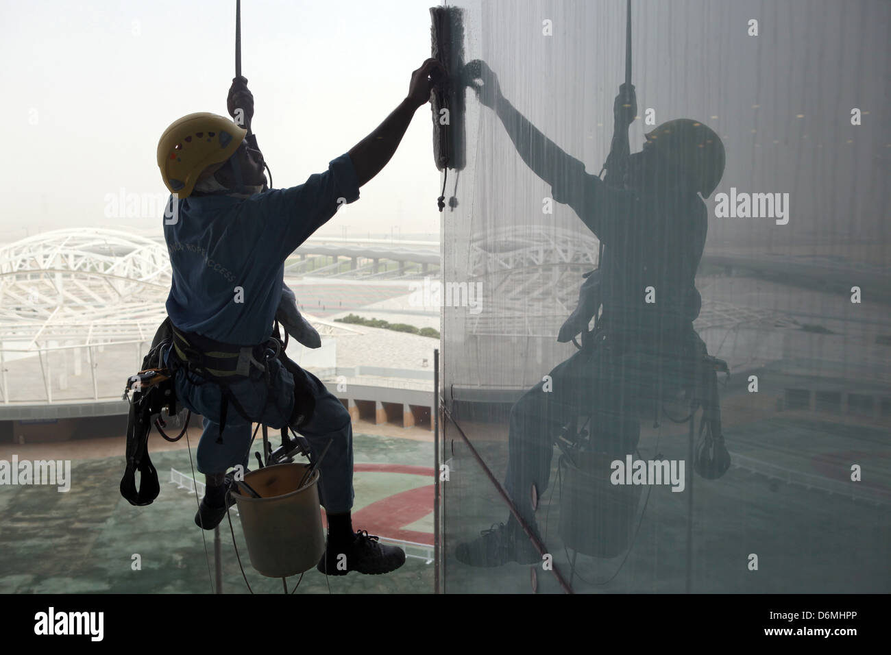 Dubai, United Arab Emirates, window cleaners at work on a glass facade Stock Photo
