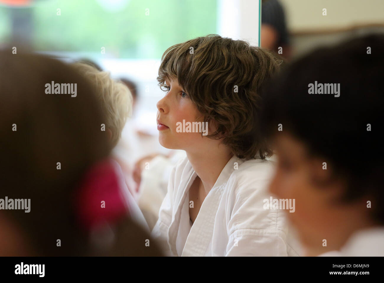 Berlin, Germany, boy in a Taekwondo course listens attentively - Stock Image