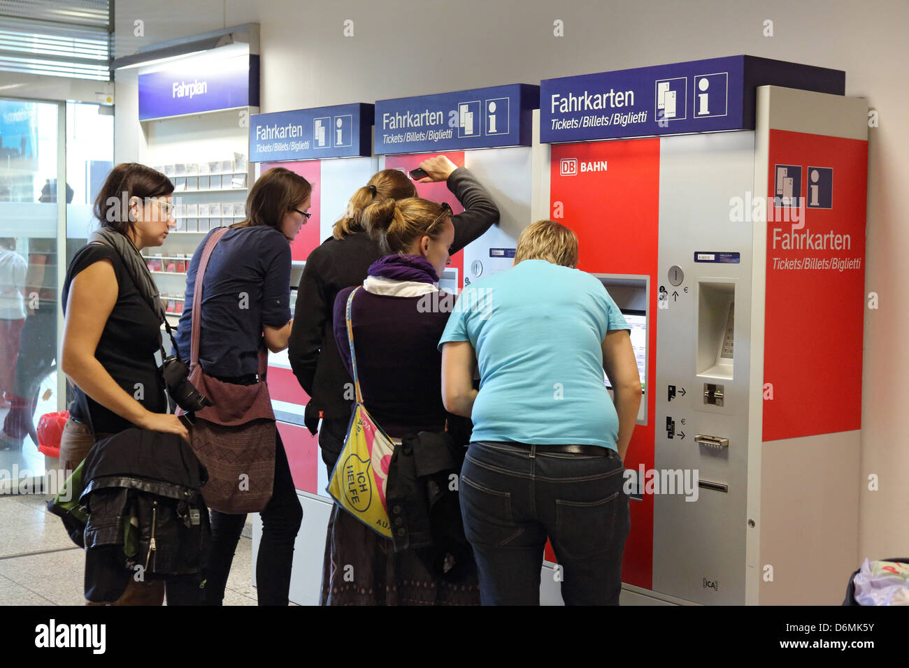 Berlin, Germany, travelers on a ticket machine - Stock Image