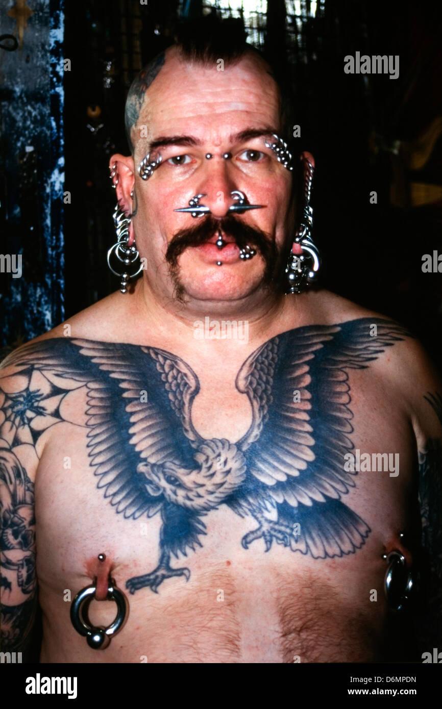 Tattooed and pierced lesbian