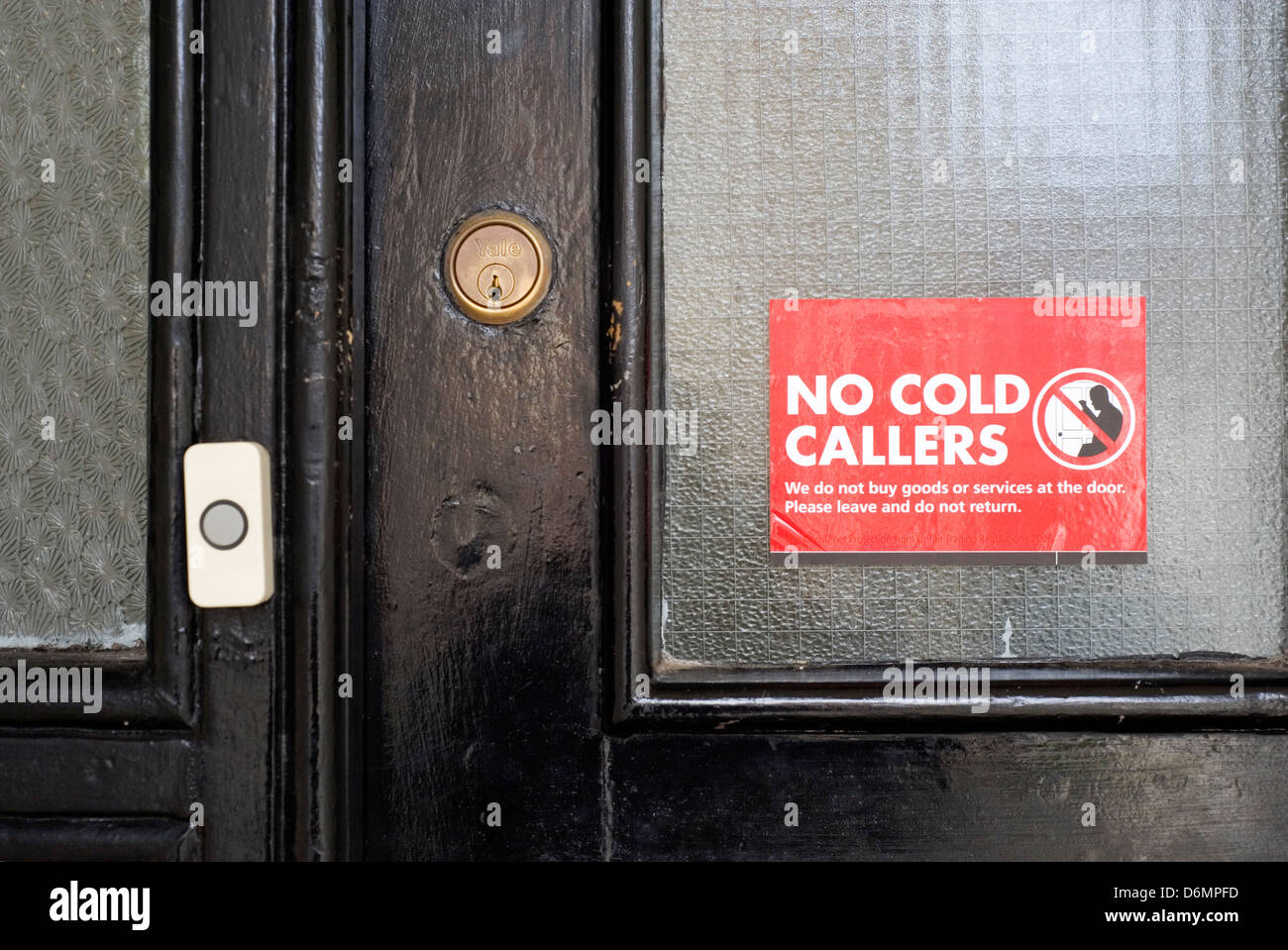 no cold callers sticker placed on a front door - Stock Image