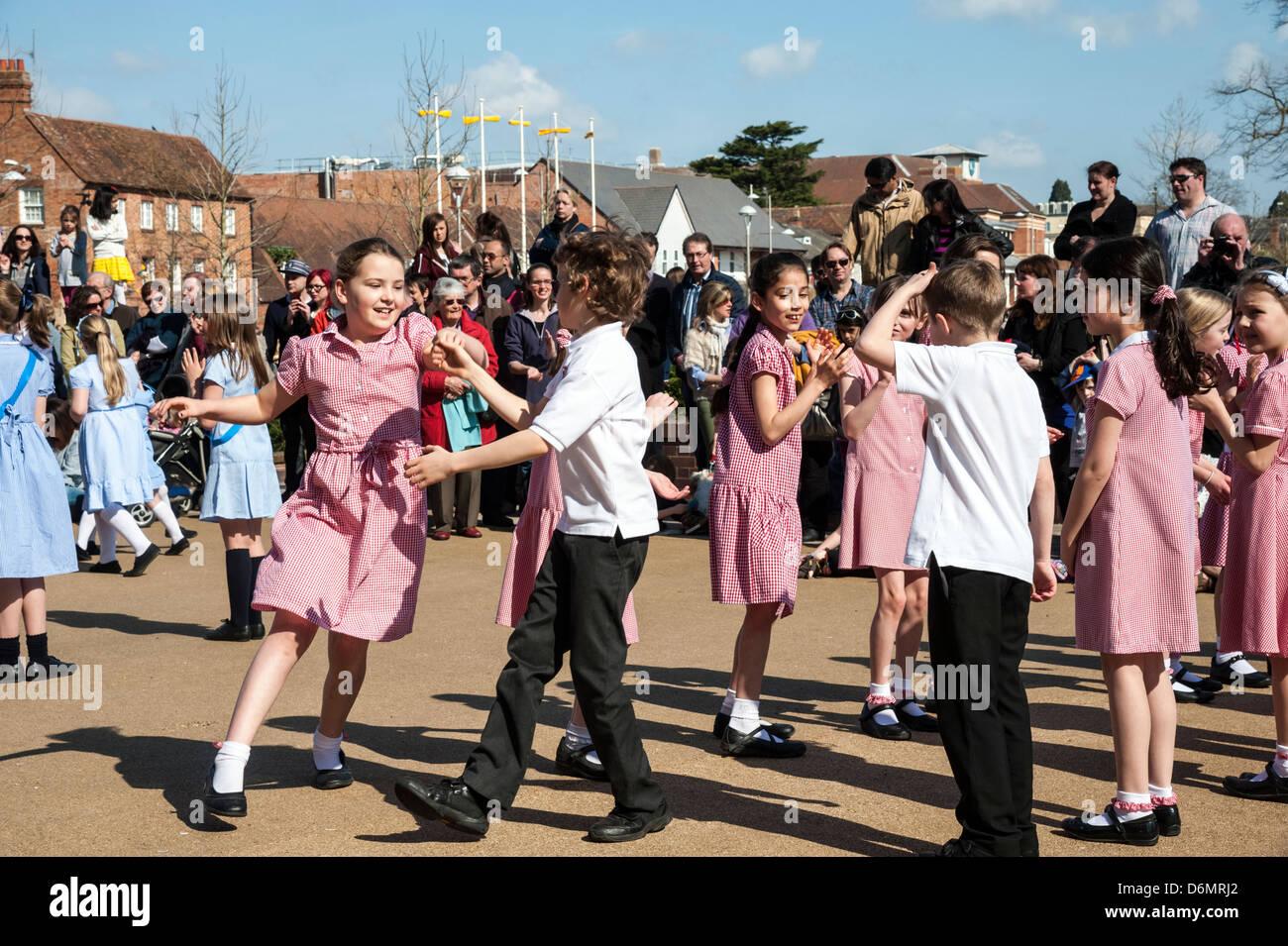 William Shakespeare birthday celebrations in Stratford upon Avon, UK. School children dancing & having fun exercising - Stock Image