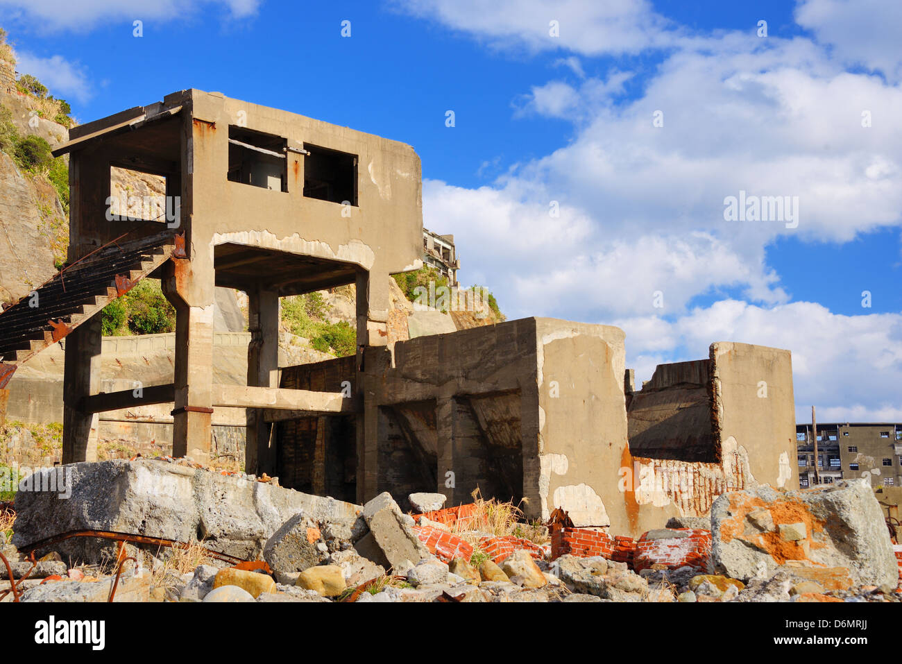 Ruins on the abandoned island of Gunkanjima off the coast of Nagasaki Prefecture, Japan. - Stock Image