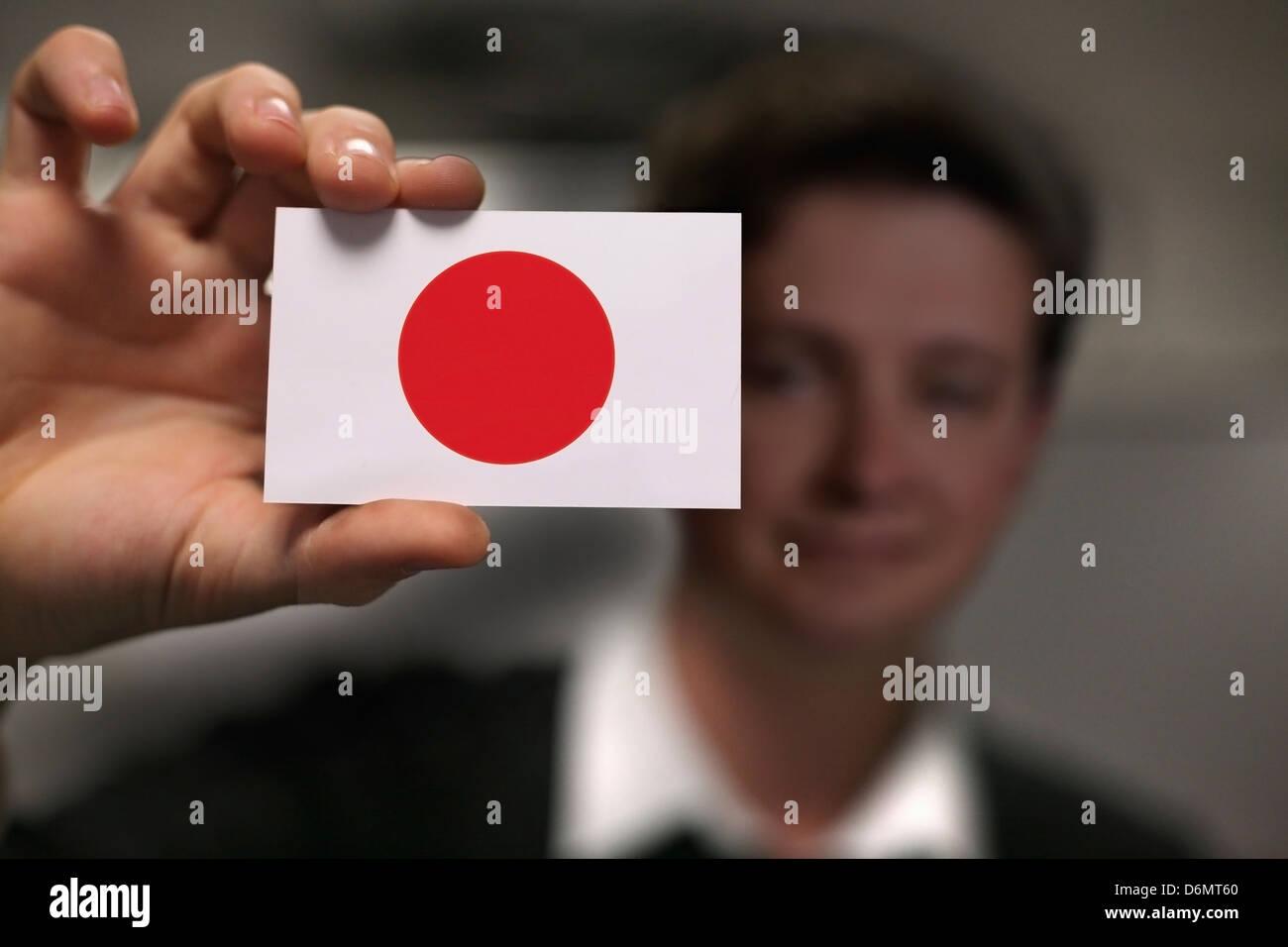 Japan business card hand stock photos japan business card hand businessman is holding a business card flag of japan stock image reheart Gallery