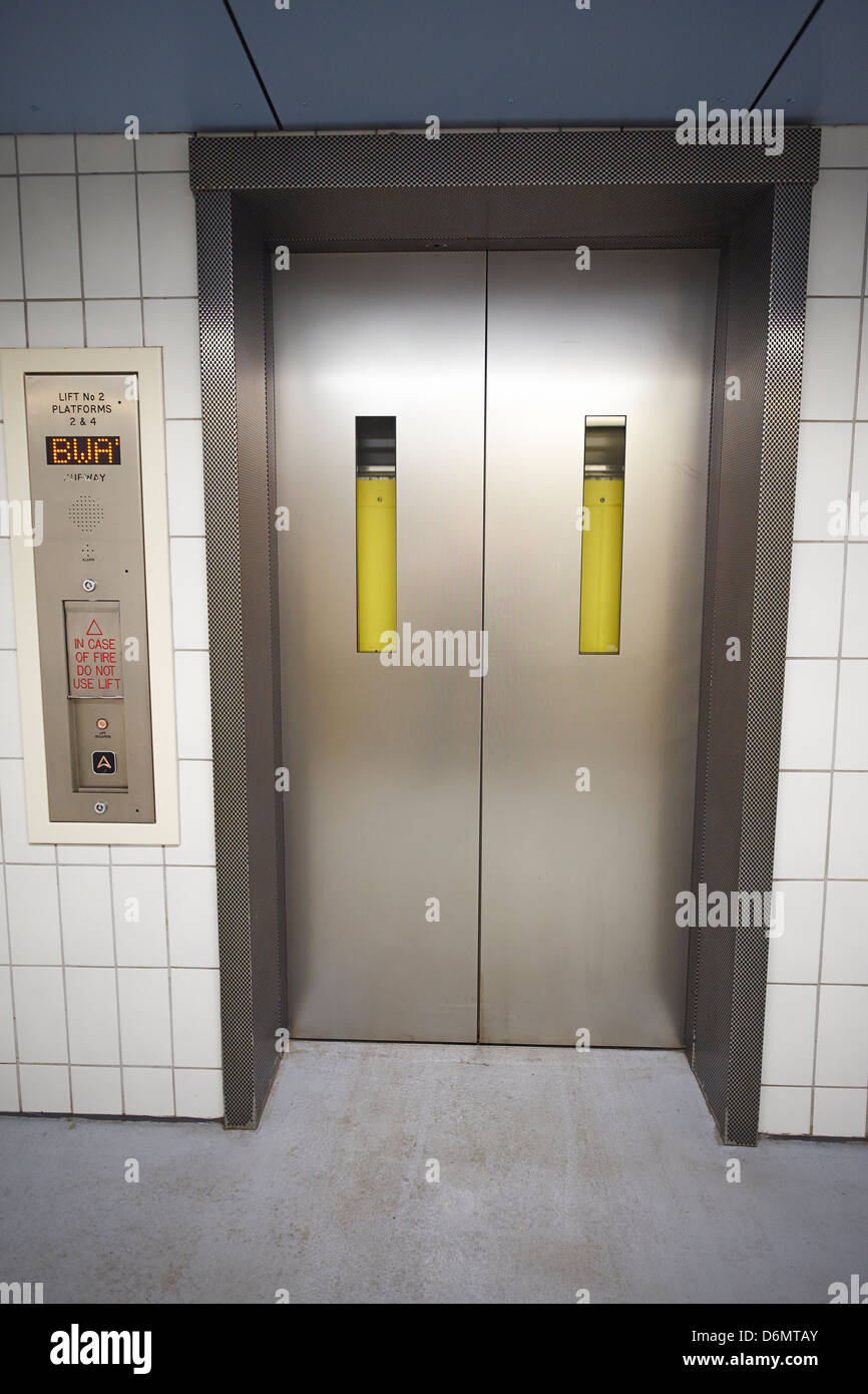 Closed passenger lift doors at Rugby Rail Station Warwickshire UK - Stock Image