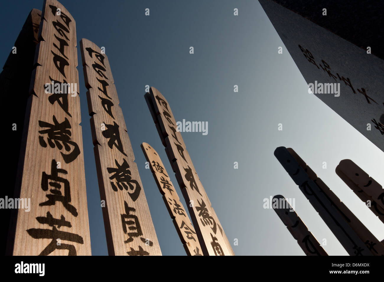A Japanese grave with Toba, wooden tablets bearing the name of deceased people, in Aoyama cemetery, Tokyo, Japan Stock Photo